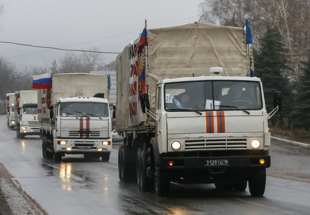 A Russian convoy of trucks carrying humanitarian aid for Ukraine are seen in Makiivka (Makeyevka) in Donetsk region, December 12, 2014. According to Russian media, over 50 trucks arrived in Donetsk while another 80 trucks arrived in Luhansk. REUTERS/Maxim Shemetov (UKRAINE - Tags: POLITICS CONFLICT SOCIETY)