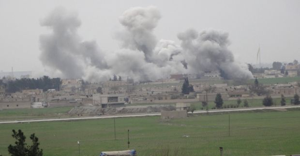 Smoke rises over the northern Syrian town of Tel Abyad as it is pictured from the Turkish border town of Akcakale, in Sanliurfa province, Turkey February 27, 2016. Islamic State militants launched an assault on a Kurdish-controlled town on Syria's border with Turkey on Saturday, prompting air strikes by the U.S.-led coalition to try to drive them back. The hardline Sunni fighters attacked Tel Abyad, which is controlled by the Syrian Kurdish YPG militia, and the nearby town of Suluk in the early hours of Saturday, YPG spokesman Redur Xelil and Turkish security sources told Reuters. REUTERS/Kadir Celikcan FOR EDITORIAL USE ONLY. NO RESALES. NO ARCHIVE.       TPX IMAGES OF THE DAY